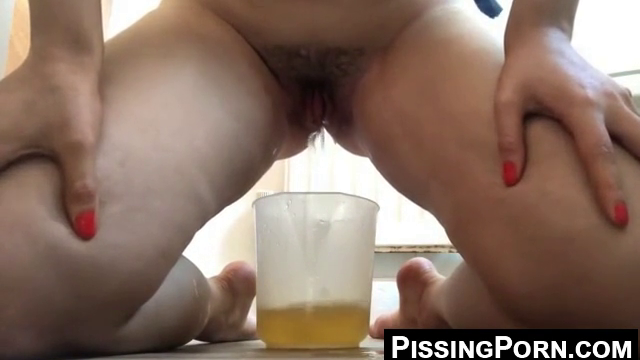 Cam Girl With Hairy Pussy Pisses In A Jug For Us Dark Yellow In Color